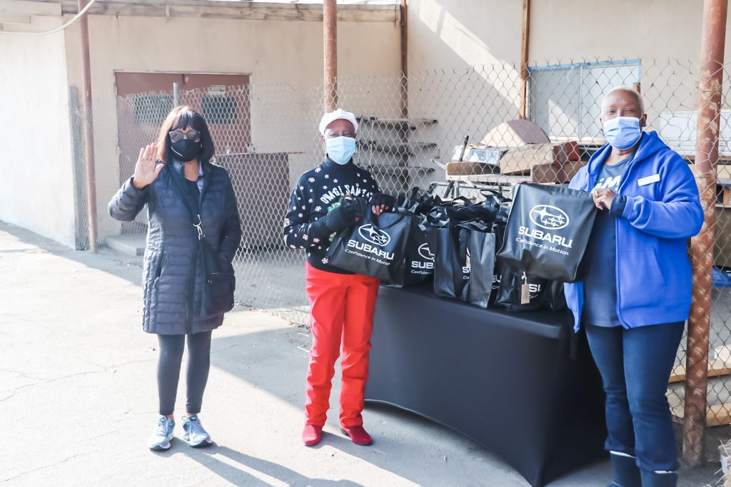 """Christmas Comes Early For Seniors At Bakersfield Senior Center """"Subaru Share The Love"""" Warm Bag Give-Away"""